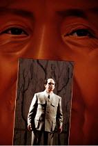 'NIXON IN CHINA' (Adams/Goodman)~framed in giant portrait of himself: Robert Brubaker (Mao Tse-tung)~English National Opera  07/06/2000