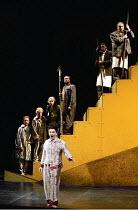 'DAS RHEINGOLD' (Wagner - director: Richard Jones   design: Nigel Lowery)~front: Bonaventura Bottone (Loge)   on steps - the Gods, l-r: Gerard Quinn (Donner), Justin Lavender (Froh), ~Felicity Palmer...