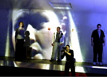 'THE RHINEGOLD' (Wagner - conductor: Paul Daniel   director: Phyllida Lloyd   design: Richard Hudson)~Erda's (Patricia Bardon) projected image, filmed by Loge - l-r: Susan Parry (Fricka), Andrew Rees...