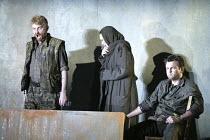 'THE VALKYRIE' (Wagner - conductor: Paul Daniel   director: Phyllida Lloyd   design: Richard Hudson)~Act I - l-r: Clive Bayley (Hunding), Orla Boylan (Sieglinde), Pr Lindskog (Siegmund) ~English Natio...