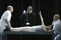 'THE VALKYRIE' (Wagner - conductor: Paul Daniel   director: Phyllida Lloyd   design: Richard Hudson)~Act III - Wotan prepares to sedate BrUnnhilde: Robert Hayward (Wotan), Kathleen Broderick (BrUnnhil...