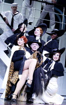 'ANYTHING GOES' (Porter/Wodehouse/Bolton/Lindsay/Crouse)~front left: Sally Ann Triplett (Reno Sweeney)   centre: Anthony Cable (Henry T Dobson)~Olivier Theatre / National Theatre, London SE1...