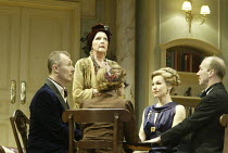 'BLITHE SPIRIT' (Coward - director: Thea Sharrock)~preparing for the seance - l-r: Aden Gillett (Charles), Penelope Keith (Madame Arcati), (back to camera) Ann Penfold (Mrs Bradman), Joanna Riding (Ru...