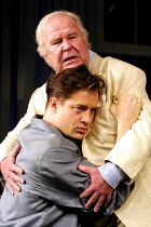 CAT ON A HOT TIN ROOF  by Tennessee Williams  design: Maria Bjornson  lighting: Howard Harrison  director: Anthony Page ~(top) Ned Beatty (Big Daddy), Brendan Fraser (Brick)~Lyric Theatre, London W1...