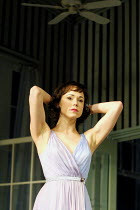 CAT ON A HOT TIN ROOF  by Tennessee Williams  design: Maria Bjornson  lighting: Howard Harrison  director: Anthony Page ~Frances O'Connor (Margaret)~Lyric Theatre, London W1  18/09/2001~(c) Donald Coo...