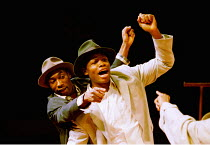 'LE COSTUME' (Can Themba)  directed by Peter Brook~l-r: Cyril Guei (KK, Joe), Hubert Kound (Philemon)~LIFT/Young Vic Theatre, London SE1  25/01/2001