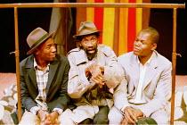 'LE COSTUME' (Can Themba)  directed by Peter Brook~l-r: Cyril Guei (KK, Joe), Sotigui Kouyat (Maphikela), Hubert Kound (Philemon)~LIFT/Young Vic Theatre, London SE1  25/01/2001