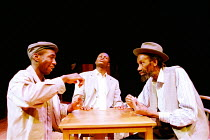 'LE COSTUME' (Can Themba)  directed by Peter Brook,playing cards, l-r: Cyril Guei (KK, Joe), Hubert Kound� (Philemon), Sotigui Kouyat� (Maphikela),LIFT/Young Vic Theatre, London SE1  25/01/2001,