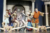 rear left: David Schneider (Lycus)  right: Desmond Barrit (Prologus) with courtesans in A FUNNY THING HAPPENED ON THE WAY TO THE FORUM at the Olivier Theatre, National Theatre (NT), London SE1 09/07/2...