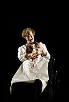 'SWEENEY TODD' (Sondheim)~Todd despatches a victim: Steven Page (Sweeney Todd)~Opera North/Leeds               25/04/2002