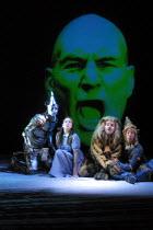 'THE WIZARD OF OZ' (Baum)~l-r: Ken Bradshaw (Tin Man), Charlie Hayes (Dorothy Gale), Tony Timberlake (Lion), Simon Quarterman (Scarecrow) ~with the head of Patrick Stewart (Virtual Wizard of Oz)~West...