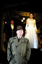 'AN INSPECTOR CALLS' (JB Priestley)~Niall Buggy (Inspector Goole) with (rear) Edward Peel (Mr Birling), Emma Gregory (Sheila Birling)~Playhouse Theatre, London WC2       27/09/2001