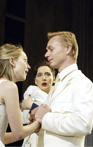 'IPHIGENIA AT AULIS' (Euripides, translated by Don Taylor   director: Katie Mitchell)~l-r: Hattie Morahan (Iphigenia), Kate Duchene (Clytemnestra), Ben Daniels (Agamemnon)~Lyttelton Theatre / National...