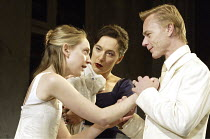 'IPHIGENIA AT AULIS' (Euripides, translated by Don Taylor   director: Katie Mitchell)~l-r: Hattie Morahan (Iphigenia), Ben Daniels (Agamemnon), Kate Duchene (Clytemnestra)~Lyttelton Theatre / National...