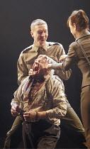 LEAR (Edward Bond - director: Jonathan Kent),the torture of Warrington - l-r: Sam Spruell (Soldier), Patrick Godfrey (Warrington), Claudie Blakley (Bodice),Crucible Theatre / Sheffield, England    15/...