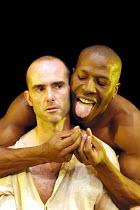 'MESSIAH - Scenes from a Crucifixion' (Berkoff)~l-r: Finbar Lynch (Jesus), Cornell John (Satan)~Riverside Studios, London W6                 03/10/2001