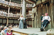 KING LEAR   by Shakespeare   director/^Master of Play^: Barry Kyle ~Gloucester blinded - left: Felicity Dean (Regan)   right, tied to chair: Geoffrey Whitehead (Gloucester)~Shakespeare's Globe, London...