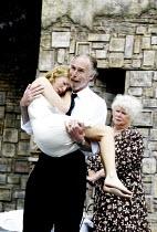 'ROMEO AND JULIET' (Shakespeare)~l-r: Laura Main (Juliet), Christopher Godwin (Capulet), Carol Macready (Nurse)~Open Air Theatre/Regent's Park, London NW1      05/06/2002