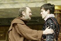 'ROMEO AND JULIET' (Shakespeare - director ('Master of Play') Tim Carroll)~III/iii - l-r: John McEnery (Friar Lawrence), Tom Burke (Romeo)~Shakespeare's Globe, London SE1         19/05/2004