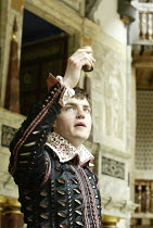 'ROMEO AND JULIET' (Shakespeare - director ('Master of Play') Tim Carroll)~in the tomb, Romeo prepares to take poison: Tom Burke (Romeo)~Shakespeare's Globe, London SE1         19/05/2004