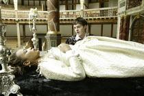 'ROMEO AND JULIET' (Shakespeare - director ('Master of Play') Tim Carroll)~Romeo finds Juliet in the tomb: Kananu Kirimi (Juliet), Tom Burke (Romeo)~Shakespeare's Globe, London SE1         19/05/2004