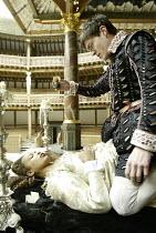 'ROMEO AND JULIET' (Shakespeare - director ('Master of Play') Tim Carroll)~in the tomb, Romeo prepares to take poison: Kananu Kirimi (Juliet), Tom Burke (Romeo)~Shakespeare's Globe, London SE1...