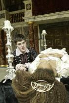 'ROMEO AND JULIET' (Shakespeare - director ('Master of Play') Tim Carroll)~in the tomb: Tom Burke (Romeo), Kananu Kirimi (Juliet)~Shakespeare's Globe, London SE1         19/05/2004