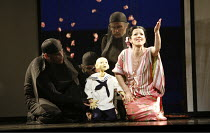 MADAM BUTTERFLY   by Puccini   conductor: David Parry   director: Anthony Minghella,Mary Plazas (Cio-Cio-San / Madam Butterfly) with puppet of her son Sorrow                           (puppetry by Bli...
