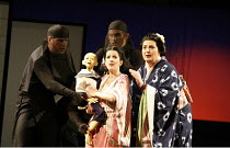 MADAM BUTTERFLY   by Puccini   conductor: David Parry   director: Anthony Minghella,l-r: Mary Plazas (Cio-Cio-San / Madam Butterfly) holding puppet of her son Sorrow, Jean Rigby (Suzuki)   (puppetry b...