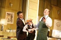 THE ELIXIR OF LOVE (L^ELISIR D^AMORE)   by Donizetti   conductor: Tecwyn Evans   director: Daniel Slater<br>,l-r: Peter Savidge (Dulcamara), Aaron Eastwood (Dulcamara^s boy), Andrew Kennedy (Nemorino)...
