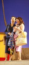 THE ELIXIR OF LOVE (L^ELISIR D^AMORE)   by Donizetti   ,conductor: Tecwyn Evans   director: Daniel Slater<br>,l-r: Susanna Andersson (Gianetta), Anna Ryberg (Adina),Opera North / Leeds, England      2...