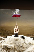 HAPPY DAYS (OH LES BEAUX JOURS)   by Samuel Beckett   director: Deborah Warner   ,set design: Tom Pye   lighting design: Jean Kalman <br>,Fiona Shaw (Winnie) with the exploding umbrella,Lyttelton Thea...