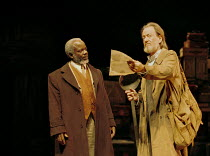 'PEER GYNT' (Ibsen)~l-r: Joseph Marcell (Peer Gynt), Ronald Pickup (The Button Moulder)~Royal National Theatre/Olivier Theatre, London  13/11/2000