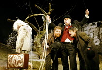 'WAITING FOR GODOT' (Beckett)~l-r: John Cormack (Lucky), David Ganly (Estragon), Gerard Murphy (Pozzo), Paul McCleary (Vladimir) ~Theatre Royal, Northampton                    20/02/2003