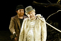 'WAITING FOR GODOT' (Beckett)~l-r: David Ganly (Estragon), John Cormack (Lucky)~Theatre Royal, Northampton                    20/02/2003
