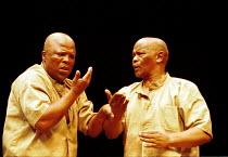 'THE ISLAND' (Fugard/Kani/Ntshona)~l-r: John Kani, Winston Ntshona~RNT/Lyttelton Theatre  26/01/2000