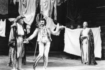 THE TAMING OF THE SHREW   by Shakespeare   director: Barry Kyle,l-r: Edward Jewesbury (Vincentio), John Bowe (Tranio), (behind sheet) Pete Postlethwaite (Grumio) & Sinead Cusack (Katherine), John Carl...