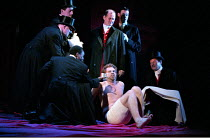 THE TAMING OF THE SHREW   by Shakespeare - director: Gale Edwards,Induction - Sly awakens - rear centre: Paul Bentall (The Lord)   sitting: Michael Siberry (Christopher Sly),Royal Shakespeare Company...