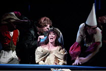 THE TAMING OF THE SHREW   by Shakespeare - director: Gale Edwards,IV/i - Katherina tormented at table - centre: Josie Lawrence (Katherina)  behind her: Michael Siberry (Petruchio),Royal Shakespeare Co...