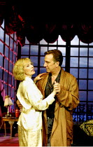 PRIVATE LIVES by Noel Coward  set design: Tim Hatley  costumes: Jenny Beavan  lighting: Peter Mumford  director: Howard Davies ~Lindsay Duncan (Amanda), Alan Rickman (Elyot)~Albery Theatre, London WC2...