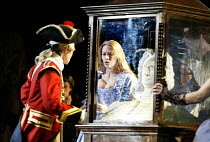 'ALCINA' (Handel)~left (in uniform): Deanne Meek (Ruggiero)   through glass case: Charlotte Hellekant (Bradamante)~English National Opera / London Coliseum, London WC2                 16/04/2003