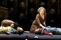 'COSI FAN TUTTE' (Mozart)~the sisters with their 'dead' suitors - l-r: Mary Plazas (Dorabella) with Christopher Maltman (Guglielmo), Susan Gritton (Fiordiligi) with Toby Spence (Ferrando)~English Nati...