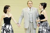 'COSI FAN TUTTE' (Mozart - director: Samuel West)~l-r: Mary Plazas (Fiordiligi), Andrew Shore (Don Alfonso), Victoria Simmonds (Dorabella)~English National Opera / Barbican Theatre, London EC2...
