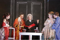 'COSI FAN TUTTE' (Mozart - conductor: Yves Abel   director: Tim Albery),Act 2 - Despina as 'lawyer' conducts the wedding - l-r: Ann Taylor (Dorabella), Roderick Williams (Guglielmo), Claire Wild (Desp...