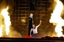 'DON GIOVANNI' (Mozart - director: Francesca Zambello   design: Maria Bjrnson   lighting: Paul Pyant)~Act II - Giovanni descends to Hell: Robert Lloyd (Commendatore), Gerald Finley (Don Giovanni)~The...