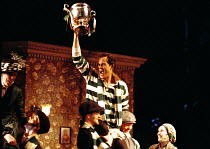 'THE SILVER TASSIE' (Turnage)~held aloft in triumph with the Silver Tassie: Gerald Finley (Harry Heeegan)~English National Opera  16/02/2000
