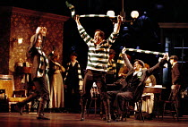 'THE SILVER TASSIE' (Turnage)~celebrating victory: Gerald Finley (Harry Heegan), with (seated) John Graham-Hall (Sylvester)~English National Opera  16/02/2000