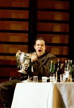 'THE SILVER TASSIE' (Turnage)~preparing to drink himself into oblivion: Gerald Finley (Harry Heegan)~English National Opera  16/02/2000