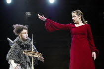 'SLEEPING BEAUTY' (Norris)~Beauty pricks her finger on the spinning wheel - l-r: Helena Lymbery (Goody), Danielle King (Beauty)   ~Young Vic Theatre, London SE1                                       0...