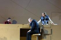 'FROM MORNING TO MIDNIGHT' (Sawer/Kaiser) at the Bank, l-r: Linda Kitchen (Bellboy), John Daszak (Cashier), Kathryn Harries (Lady) English National Opera, London  27/04/2001